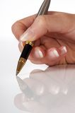 Mano e penna Fotografie Stock Libere da Diritti