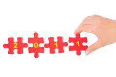 Mano e puzzle 2011 Immagine Stock Libera da Diritti