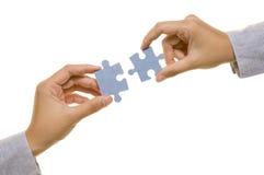 Mano e puzzle Fotografia Stock Libera da Diritti