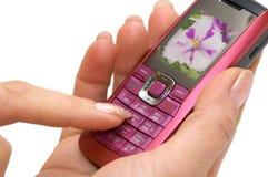 Mano e telefono immagine stock