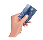 Mano e una carta di credito. Fotografie Stock Libere da Diritti
