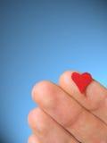 Mano en corazón Imágenes de archivo libres de regalías