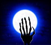 Mano en el fondo de la luna Fotos de archivo libres de regalías