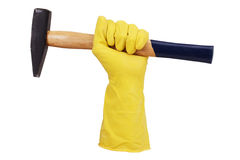 Mano en el guante de goma con un martillo Fotografía de archivo libre de regalías