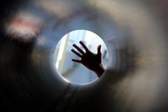 Mano en el tubo Fotografía de archivo libre de regalías