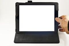 Mano en la tableta de Digitaces con la pantalla en blanco Imagen de archivo libre de regalías