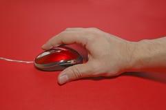 Mano en la tapa del ratón? Imagen de archivo