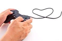 Mano en regulador negro del juego Imagenes de archivo