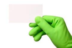 Mano en tarjeta de visita verde de demostración del guante Fotografía de archivo