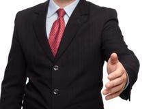 Mano en un traje de negocios que da la mano Fotos de archivo libres de regalías