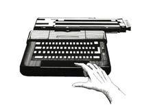 Mano en una máquina de escribir Imagenes de archivo