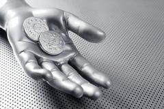 Mano euro futurista de la plata de moneda del asunto Fotografía de archivo libre de regalías
