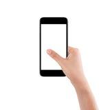 Mano femenina aislada que sostiene un teléfono móvil con la pantalla blanca fotos de archivo
