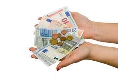 Mano femenina con diverso euro aislado Imágenes de archivo libres de regalías