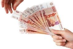 Mano femenina con el dinero Imagen de archivo libre de regalías