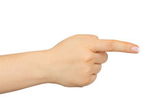 Mano femenina con el finger que muestra a la derecha Fotos de archivo libres de regalías