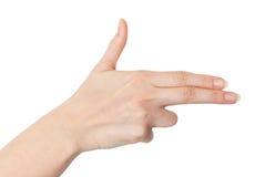 Mano femenina con los fingeres que señalan o que fingen tirar con a Fotografía de archivo libre de regalías