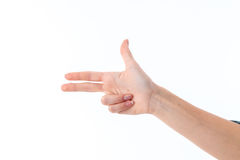 Mano femenina que muestra con el gesto de tres fingeres aislado en el fondo blanco Fotos de archivo libres de regalías