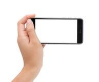 Mano femenina que sostiene la pantalla blanca del teléfono con la trayectoria de recortes dentro Imagen de archivo