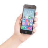 Mano femminile che tiene Smart Phone nero con l'applicazione variopinta Fotografia Stock