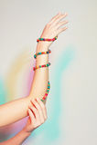 Mano femminile con i braccialetti Immagine Stock Libera da Diritti