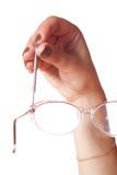 Mano femminile con il cacciavite ed i vetri Fotografia Stock