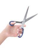 Mano femminile con le forbici aperte Fotografie Stock