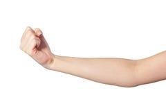 Mano femminile con un pugno chiuso isolato Fotografia Stock Libera da Diritti