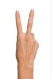 Mano femminile isolata della donna aperta vuota nella posizione del segno e del numero due di pace su un fondo bianco Fotografie Stock Libere da Diritti