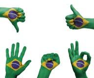 Mano fijada con la bandera del Brasil Fotografía de archivo libre de regalías