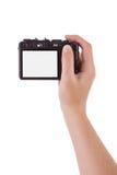 Mano fotografica con una macchina fotografica digitale fotografia stock