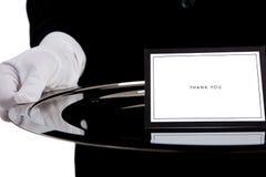 Mano gloved bianca che tiene un cassetto d'argento Fotografia Stock