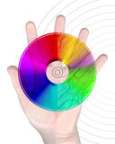 Mano humana con el disco CD imagenes de archivo