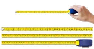 Mano humana con la cinta métrica Imágenes de archivo libres de regalías