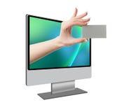 Mano humana que sale de la pantalla de ordenador Imágenes de archivo libres de regalías