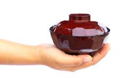 Mano humana que se considera de cerámica Imágenes de archivo libres de regalías