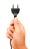 Mano humana que sostiene el enchufe Fotografía de archivo