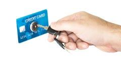 Mano isolata che sblocca la carta di credito Fotografia Stock