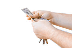 Mano isolata con i dollari del denaro contante e la chiave dell'automobile Priorità bassa bianca Mani umane che tengono le chiavi Immagine Stock Libera da Diritti