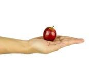 Mano isolata dell'uomo con la mela rossa su bianco Fotografia Stock