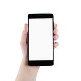 Mano izquierda adolescente femenina que sostiene smartphone aislado en blanco Imagenes de archivo
