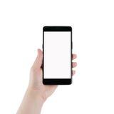 Mano izquierda adolescente femenina que sostiene smartphone aislado en blanco Fotografía de archivo