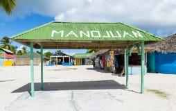 Mano Juan by i den Saona Domenican republiken Arkivbild