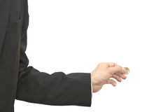 Mano maschio che pizzica la moneta del dollaro Fotografia Stock Libera da Diritti