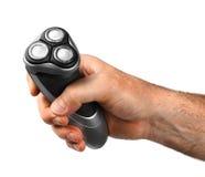 Mano masculina fuerte que sostiene la máquina de afeitar Fotografía de archivo