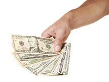 Mano masculina que lleva a cabo el manojo de notas del dólar imagenes de archivo