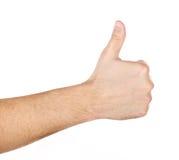 Mano masculina que muestra los pulgares encima de la muestra aislada Foto de archivo libre de regalías