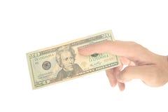Mano masculina que pellizca la nota del dólar Imagen de archivo