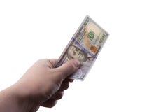 Mano masculina que sostiene cientos billetes de banco del dólar Fotos de archivo libres de regalías