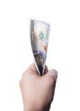 Mano masculina que sostiene cientos billetes de banco del dólar Imágenes de archivo libres de regalías